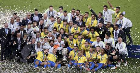Brazil's team celebrates with the trophy after the 3-1 victory over Peru at the end the final soccer match of the Copa America at the Maracana stadium in Rio de Janeiro, Brazil, Sunday, July 7, 2019. (AP Photo/Natacha Pisarenko)