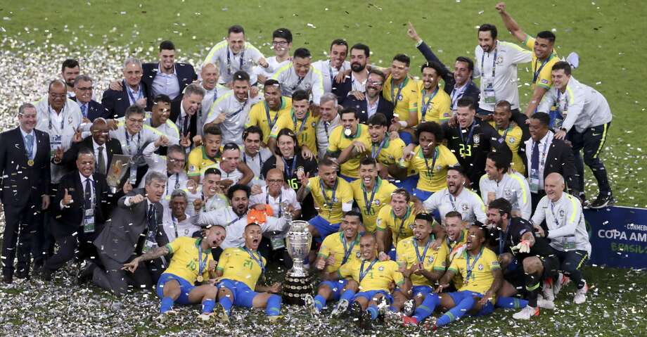 Brazil's team celebrates with the trophy after the 3-1 victory over Peru at the end the final soccer match of the Copa America at the Maracana stadium in Rio de Janeiro, Brazil, Sunday, July 7, 2019. (AP Photo/Natacha Pisarenko) Photo: Natacha Pisarenko/Associated Press