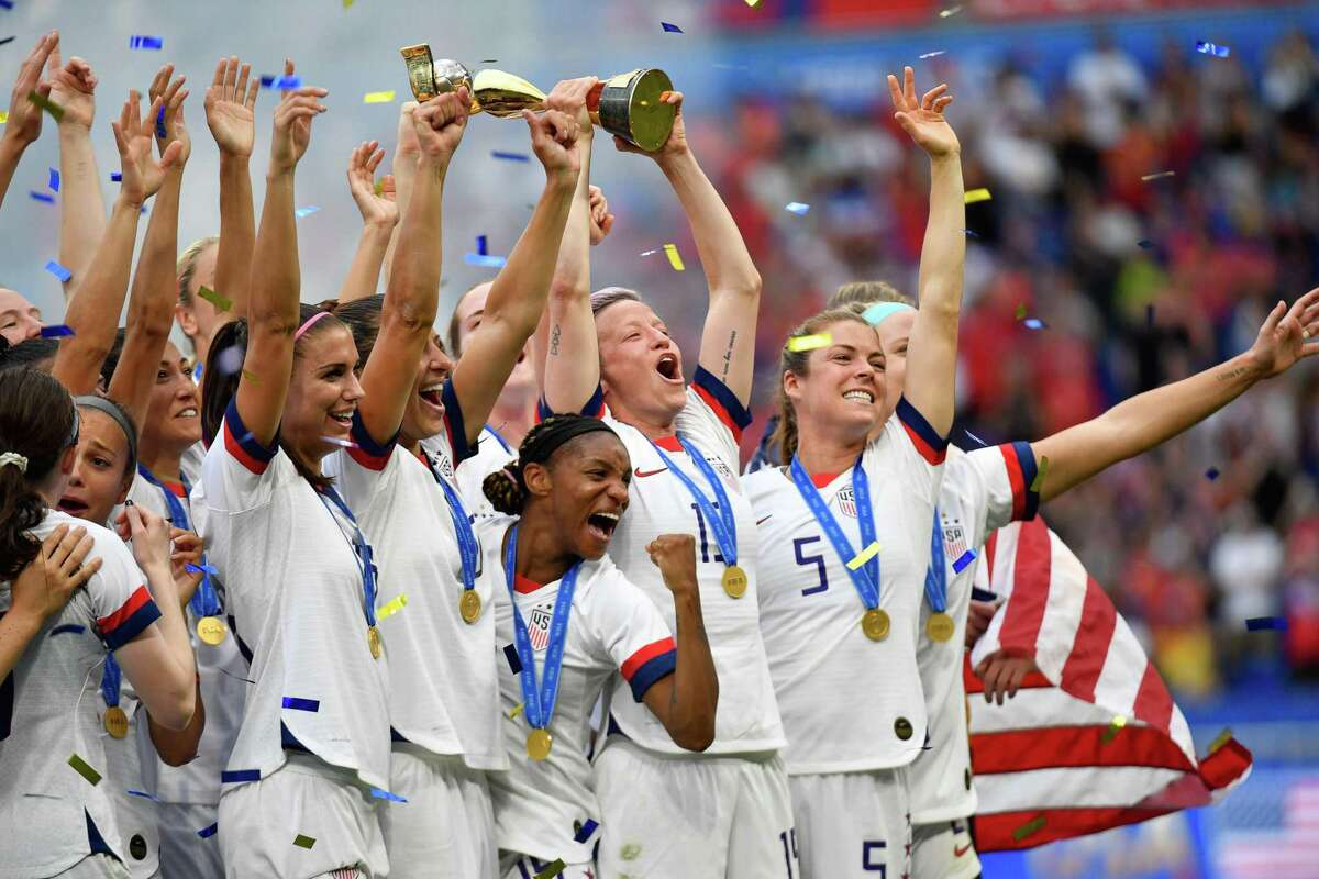 USA's players including forward Megan Rapinoe (C) celebrate with the trophy after the France 2019 Womens World Cup football final match between USA and the Netherlands, on July 7, 2019, at the Lyon Stadium in Lyon, central-eastern France.