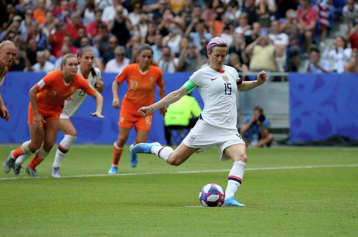United States' Megan Rapinoe scores her side's opening goal from a penalty shot during the Women's World Cup final soccer match between US and The Netherlands at the Stade de Lyon in Decines, outside Lyon, France, Sunday, July 7, 2019.