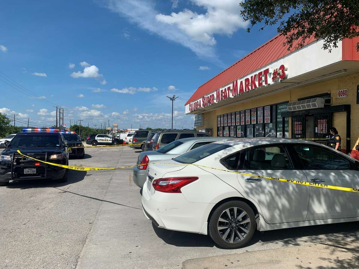 A security guard's gun accidentally fired at a small grocery on the South Side on Sunday, injuring two women.
