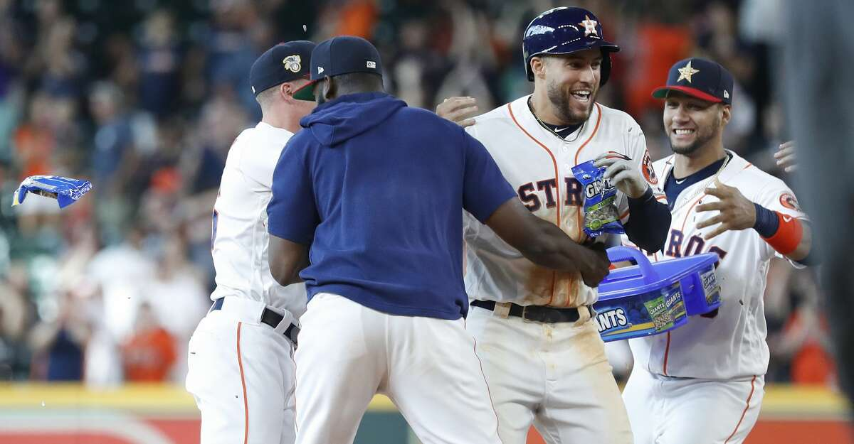 Houston Astros Yordan Alvarez (44), Myles Straw (26), and Yuli Gurriel (10) celebrate with George Springer (4) after Springer hit a walkoff RBI to beat the Los Angeles Angels 11-10 during the tenth inning of an MLB game at Minute Maid Park, Sunday, July 7, 2019, in Houston.