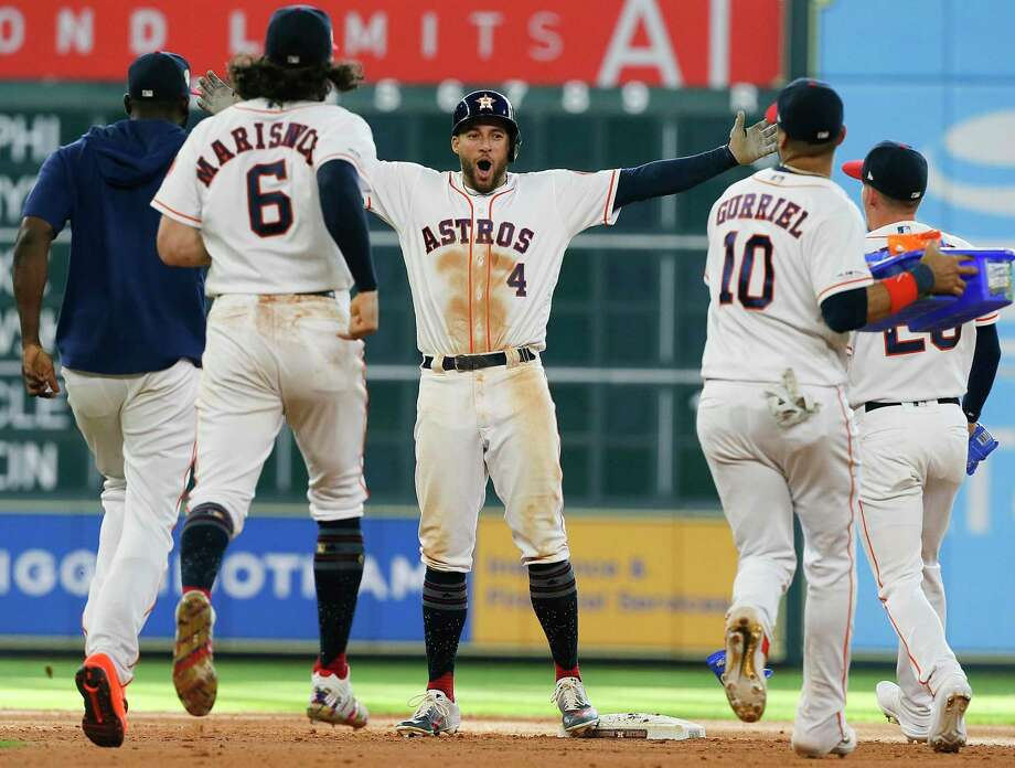 George Springer (4) of the Houston Astros celebrates a game winning single in the tenth inning against the Los Angeles Angels of Anaheim at Minute Maid Park on July 07, 2019 in Houston. Photo: Bob Levey, Stringer / Getty Images / 2019 Getty Images