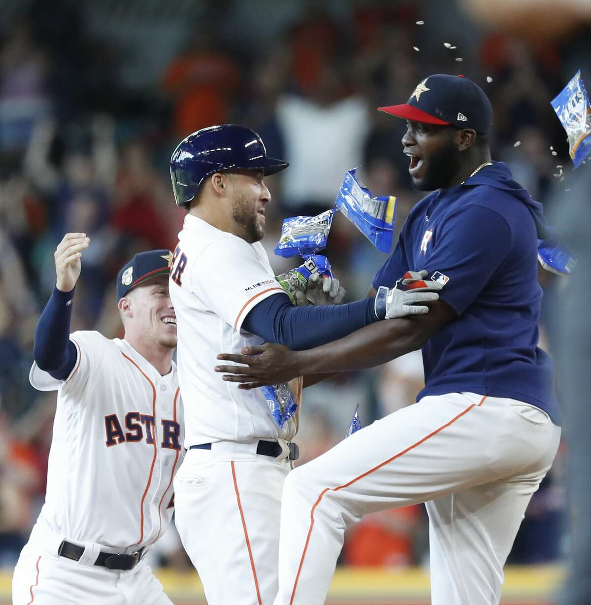 Houston Astros Yordan Alvarez (44) celebrates with George Springer (4) after Springer hit a walkoff RBI to beat the Los Angeles Angels 11-10 during the tenth inning of an MLB game at Minute Maid Park, Sunday, July 7, 2019, in Houston.