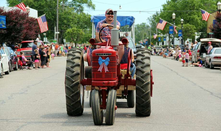 Farming and emergency vehicles travel through Port Hope during a parade on July 7, 2019. The parade capped of Port Hope's 33rd annual Fourth of July Festival. Photo: Andrew Mullin/Huron Daily Tribune