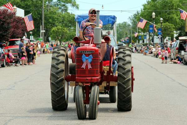 Farming and emergency vehicles travel through Port Hope during a parade on July 7, 2019. The parade capped of Port Hope's 33rd annual Fourth of July Festival.