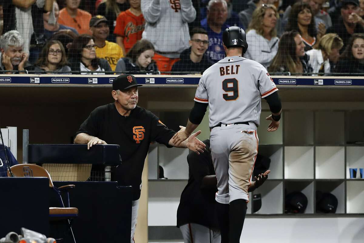 San Francisco Giants' Brandon Belt (9) is greeted by manager Bruce Bochy after scoring off a single by Austin Slater during the sixth inning of a baseball game against the San Diego Padres Wednesday, July 3, 2019, in San Diego. (AP Photo/Gregory Bull)