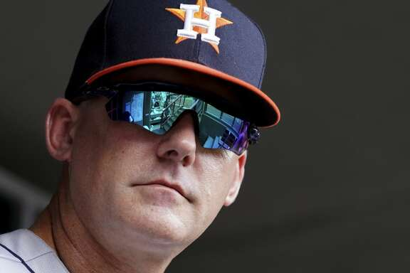 Houston Astros' manager AJ Hinch stands in the dugout in a baseball game against the Cincinnati Reds, Wednesday, June 19, 2019, in Cincinnati. The Reds won 3-2. (AP Photo/Aaron Doster)