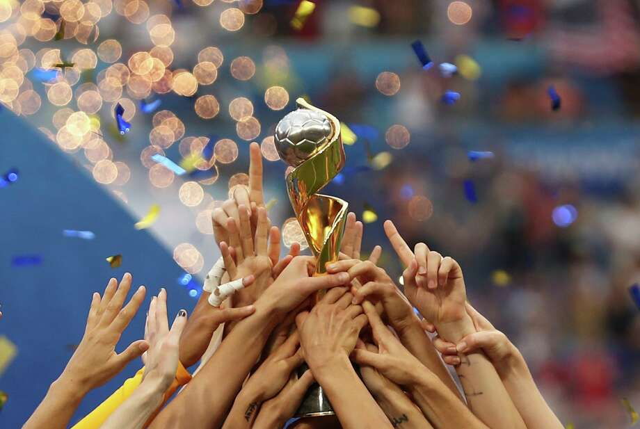 The United States players hold the trophy celebrating at the end of the Women's World Cup final soccer match between US and The Netherlands at the Stade de Lyon in Decines, outside Lyon, France, Sunday, July 7, 2019. The US defeated the Netherlands 2-0. (AP Photo/Francisco Seco) Photo: Francisco Seco, STF / Associated Press / Copyright 2019 The Associated Press. All rights reserved