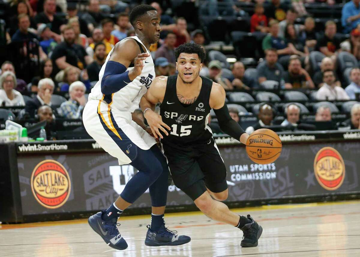 Spurs guard Quinndary Weatherspoon (15) drives around Utah Jazz guard Miye Oni during the second half of an NBA summer league game July 3, 2019, in Salt Lake City.