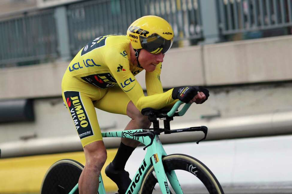 Netherlands' Mike Teunissen of the Team Jumbo Visma strains during the second stage of the Tour de France cycling race, a team time trial over 27.6 kilometers (17 miles) with start and finish in Brussels, Belgium, Sunday, July 7, 2019. (AP Photo/Thibault Camus)