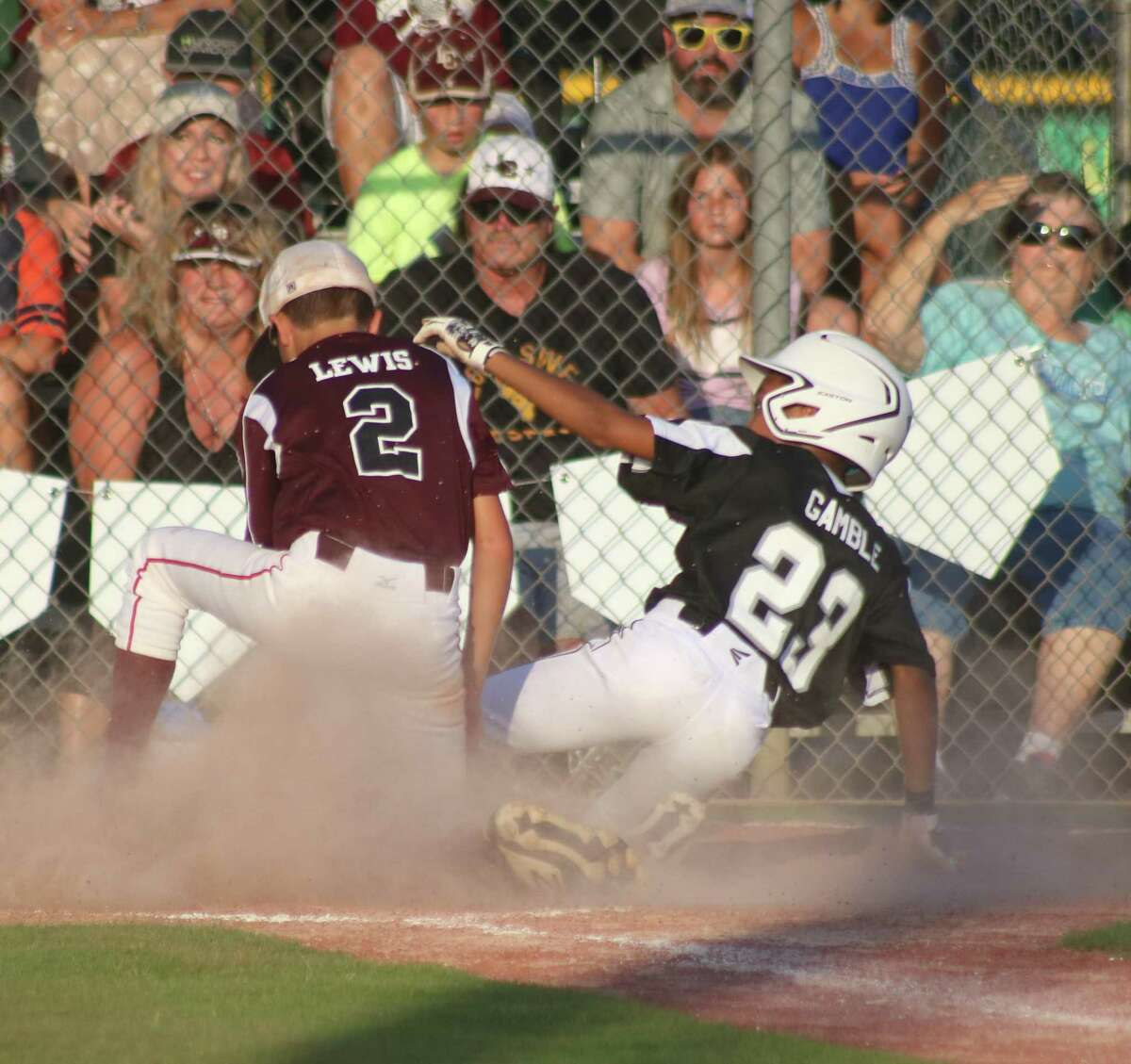 League City National pitcher Carter Lewis tags out a Pearland runner trying to increase the lead to 7-0 Sunday night.