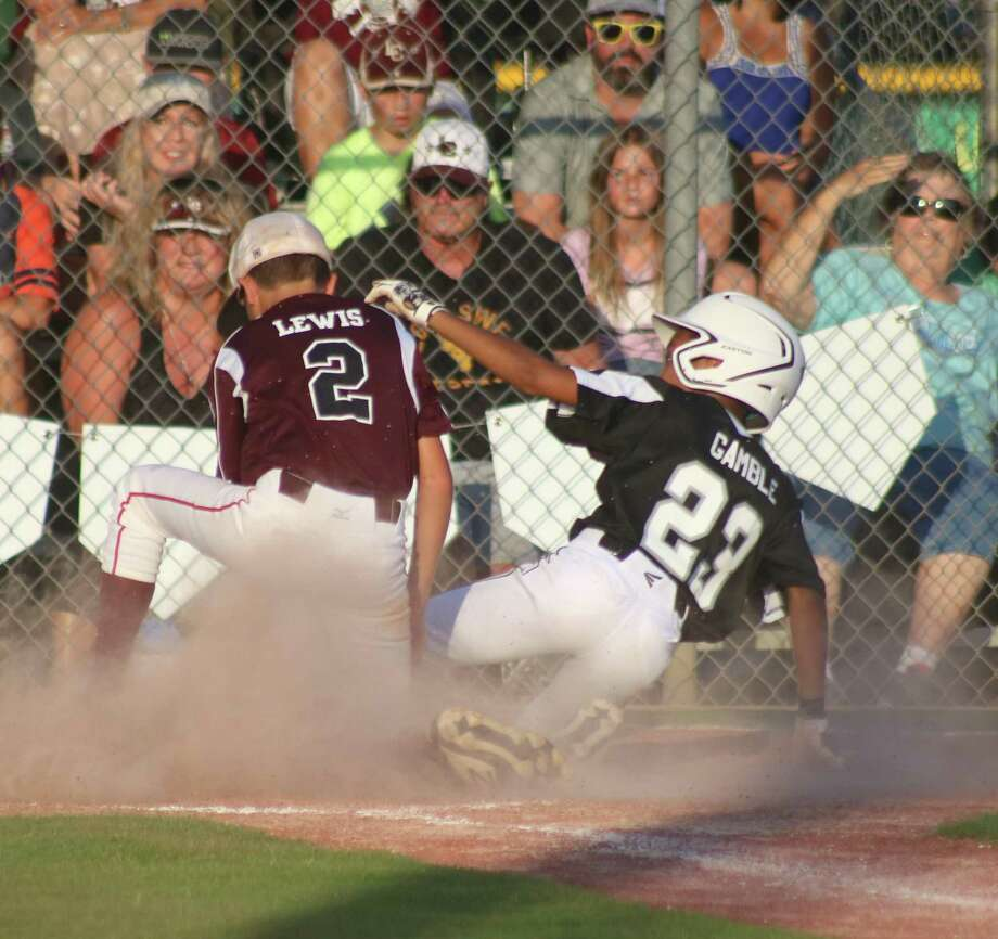 League City National pitcher Carter Lewis tags out a Pearland runner trying to increase the lead to 7-0 Sunday night. Photo: Robert Avery