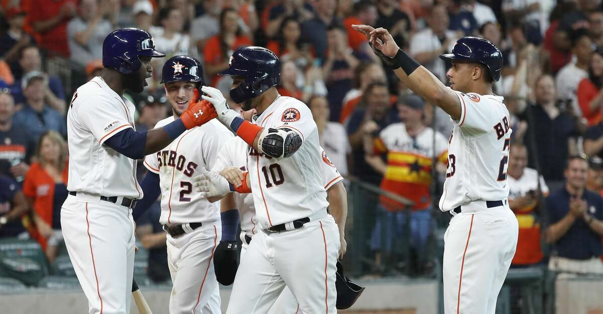 Houston Astros Yuli Gurriel (10) celebrates his grand slam with Yordan Alvarez (44), Michael Brantley (23), and Alex Bregman (2) during the sixth inning of an MLB game at Minute Maid Park, Sunday, July 7, 2019, in Houston.