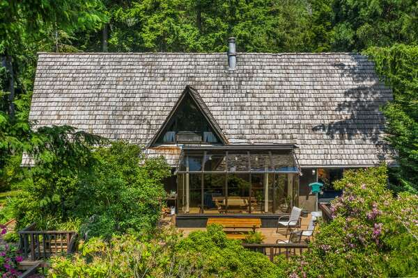 Live in a charming, untouched chalet near Lake Washington. The chance to be the 2nd owner in more than 50 years=$1.350M