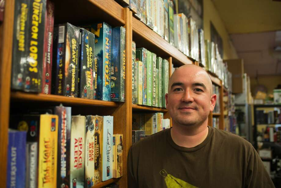 Tom Hamilton, shown here, is the owner of Gamescape in San Francisco. He took over the store, which has been open since 1985, from his father in 2009. The store, which features mostly analog games, thrives in an increasingly digital world. Photo: Drew Costley/SFGate