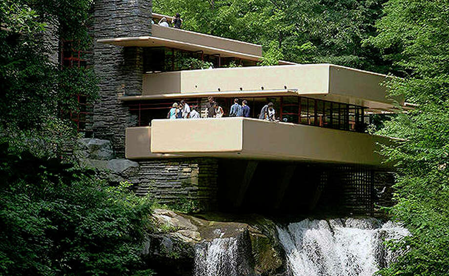 Visitors gather on one of the cantilevered terraces at Fallingwater, a Frank Lloyd Wright design in Bear Run, Pennsylvania. Eight buildings, including the Fallingwater, designed by the architect during the first half of the 20th century, where honored as World Heritage sites by United Nations Educational, Scientific and Cultural Organization on Sunday. Photo: Keith Srakocic | AP
