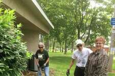 In this picture is Pat Wearmouth, Rosemary Stuehmer and Joanne Schulte planting day lilies at the Bad Axe Library in memory of Dorothian Meyer. (Submitted Photo)