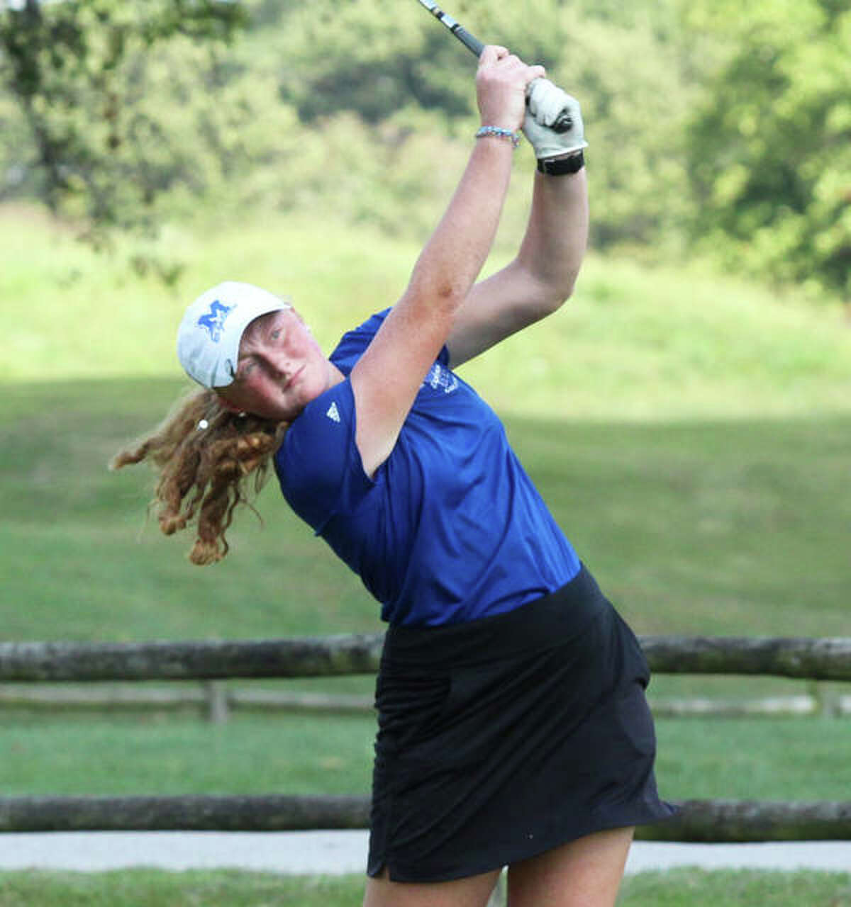 Marquette's Gracie Piar watches her shot from the tee during the Class 2A regional on Oct. 3 at Roland Barkau Memorial Golf Course in Okawville. Piar tied for tourney runner-up with a 78.