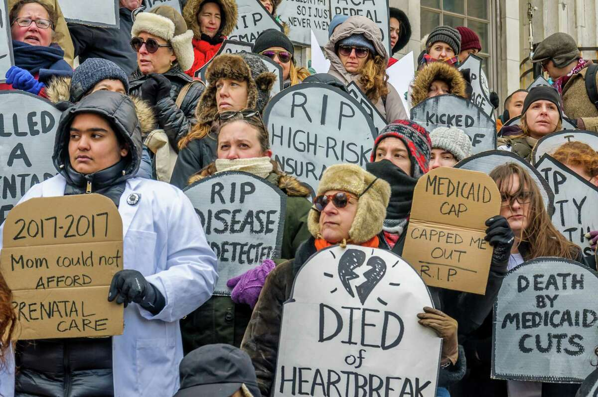 People hold a rally to protest the Republican health care bill on March 11, 2017, in New York City.