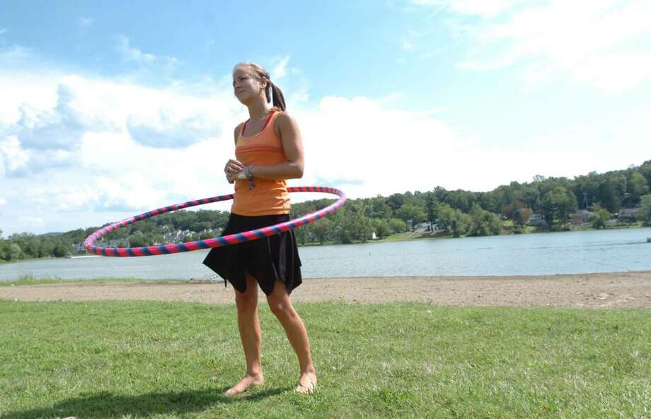 Tarah Faust, 21, of New Milford, exercises at Lake Kenosia Park in Danbury on a summer day July 29, 2010. Photo: Chris Ware / The News-Times