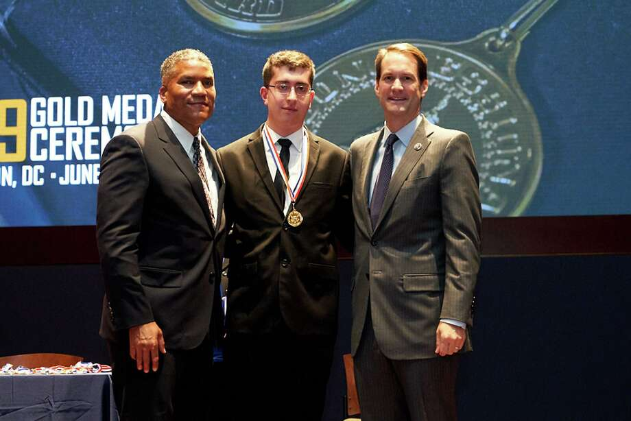 Trumbull resident Jack Ferreira (middle) is one of the recipients of the 2019 Gold Congressional Award. His award, was presented by U.S. Rep. Jim Himes (D-4th) and Congressional Award Chairman Paxton Baker. Photo: Contributed / Trumbull Times Contributed