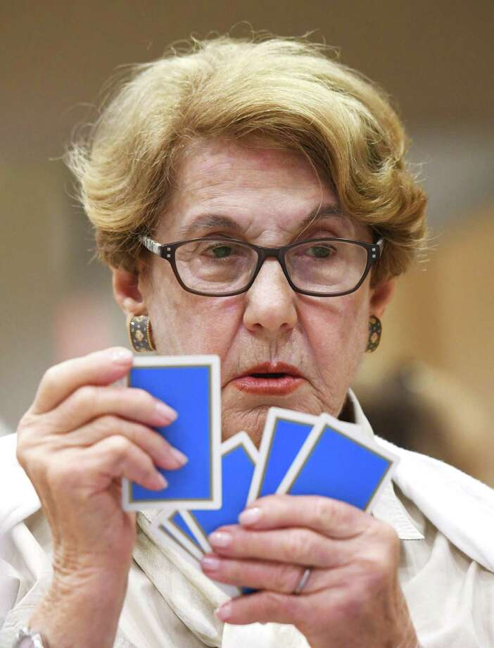 "Larchmont, N.Y. resident Karen Hershberg contemplates her next move in the Fairfield County Duplicate Bridge match at the YWCA in Greenwich, Conn. Monday, July 1, 2019. The group meets every Monday for an official match franchised by American Contract Bridge League. Master points awarded throughout the season at players participating in 15 or more games are eligible for YWCA ""Player of the Year"" awards. The games are open to both members and non-members. In addition, on Fridays there are supervised bridge games in which interesting hands are chosen for a chalkboard explanation and discussion. Photo: Tyler Sizemore / Hearst Connecticut Media / Greenwich Time"