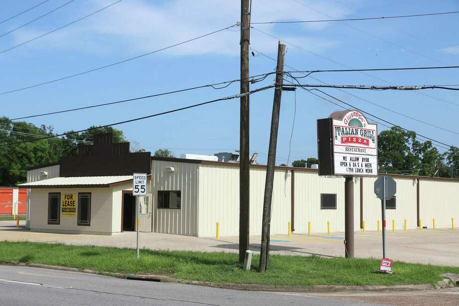 County Commissioners approved the lease of the former Giuseppe's Italian Grill Restaurant at 3210 US 90 in Liberty as their new office space. The new location will have plenty of parking for customers. Photo: David Taylor / Staff Photo