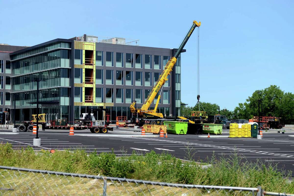 Construction site for the new Ayco headquarters on Monday, July 8, 2019, off of Route 9 in Colonie, N.Y. Ayco is the latest to install solar panels over its planned parking lot. The project will go before Colonie's planning board Tuesday evening. (Catherine Rafferty/Times Union)