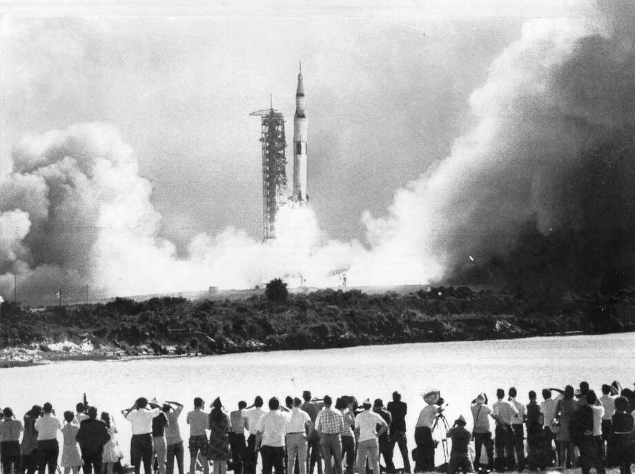 Apollo 11, with astronauts lands on the Moon  Apollo 11 blasts off from Kennedy Space Center on it's flight to put the first men on the moon, July 16, 1969   United Press International photo ran 07/17/1969, p. 1 Photo: United Press International 1969
