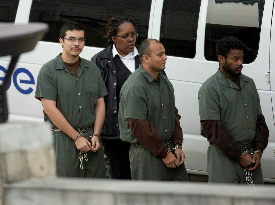 Kaan Sercan Damlarkaya, left, is brought in for hearing at the U.S. District Courthouse on Dec. 14, 2017, in downtown Houston. Damlarkaya pleaded guilty Monday in federal court to providing material support to Islamic State. Photo: Godofredo A. Vasquez, Houston Chronicle / Houston Chronicle / Godofredo A. Vasquez