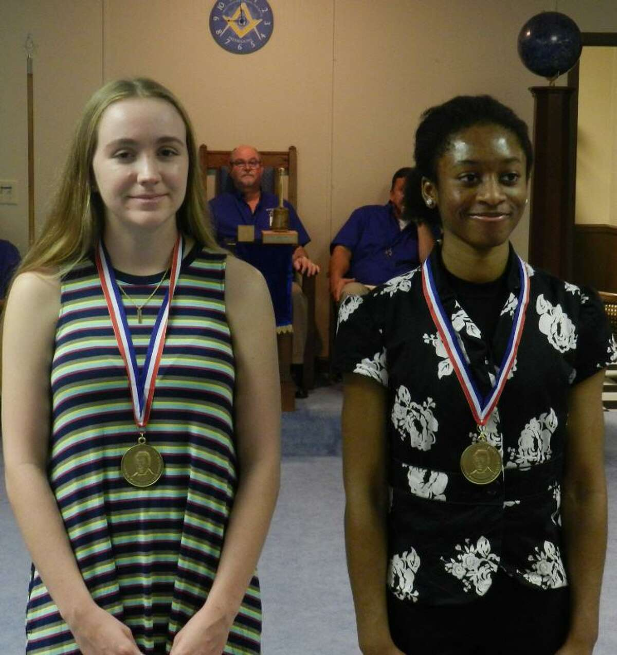 Katy Masonic Lodge 1439 gave away Lamar scholarships on June 29 to Holly Dasher, left, who graduated from Cinco Ranch High School, and Nkemasom Nwadei, who graduated from Seven Lakes High School. Each scholarship totaled $1,000. Nwadei plans to attend Texas A& University. Dasher plans to attend Mary Hardin Baylor. The scholarship is named after Mirabeau B. Lamar, a Mason, who became president of the Republic of Texas.