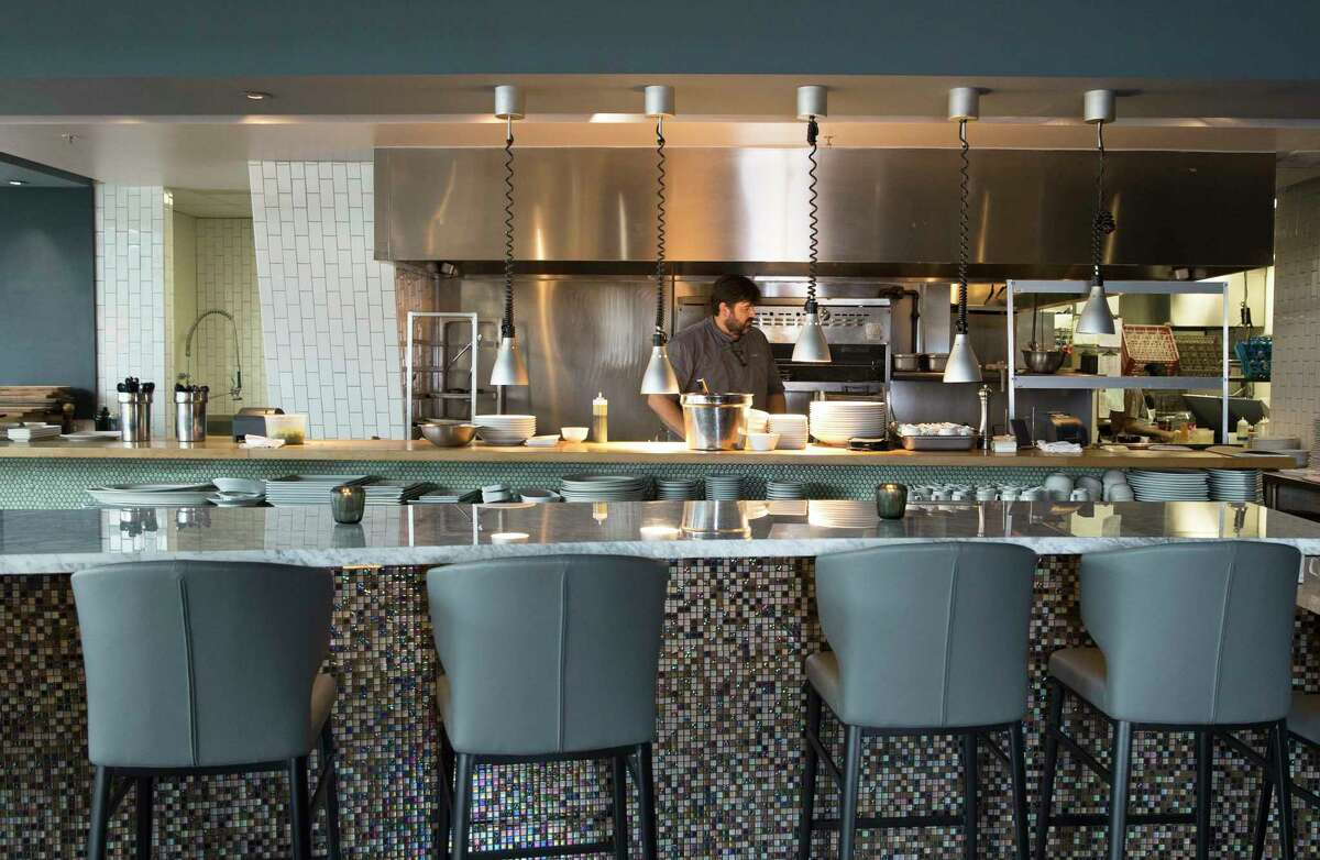 Reef Chef Bryan Caswell works at the kitchen on Wednesday, July 3, 2019, in Houston. The restaurant has been closed since Hurricane Harvey. On June 7th, the restaurant specializing in Gulf Coast seafood finally reopened its dining room.