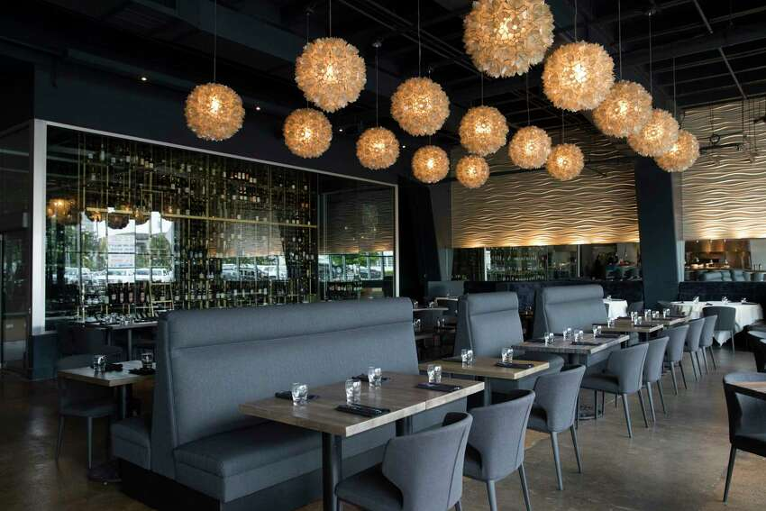 The dining room at the reopened Reef designed by Erin Hicks.