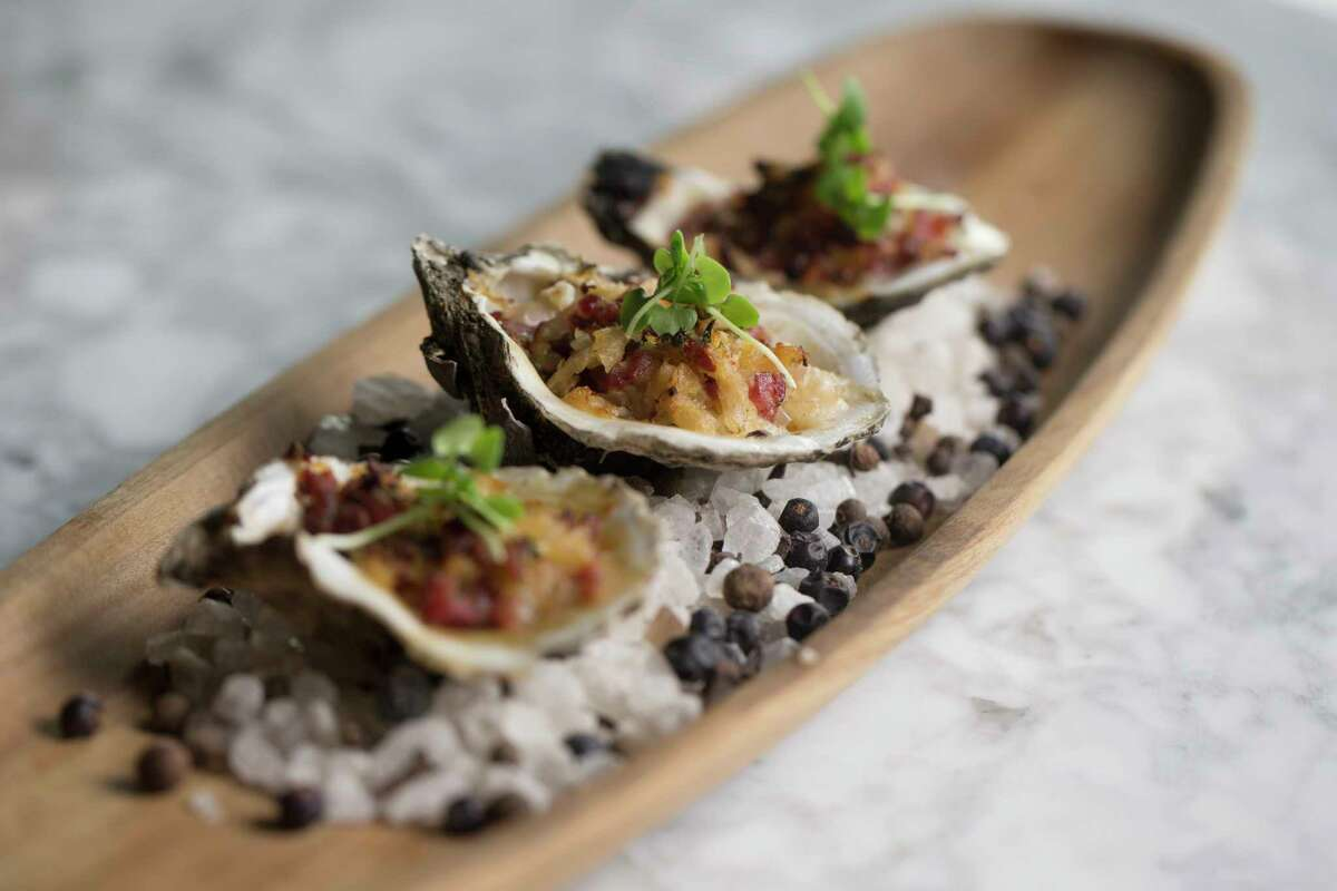 """The """"Oysters Ghutz"""" at Reef: Roasted Gulf oysters with Shiner beer-washed sauerkraut and Pasek's jalapeno sausage, a dish inspired by the Czech heritage a friend of chef Bryan Caswell."""