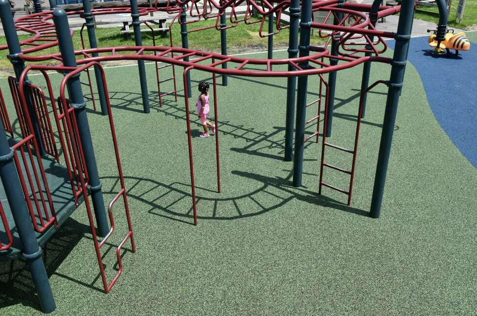 The Crossings of Colonie playground has a new low-impact rubber surface on Monday, July 8, 2019, in Colonie, N.Y. The playground reopened Monday after being closed for repairs. (Will Waldron/Times Union)