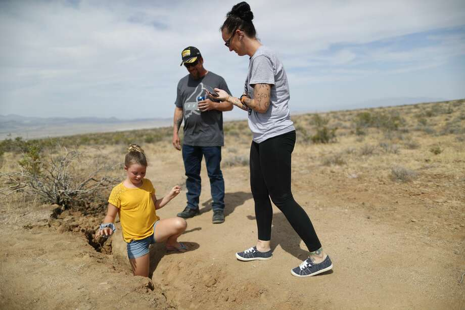 Ridgecrest residents take photos at a recent fault rupture following two large earthquakes in the area on July 7, 2019 near Ridgecrest, California. A 6.4 magnitude 'foreshock' on July 4 was followed by a 7.1 magnitude earthquake the next day. The 7.1 magnitude temblor was the largest in Southern California in twenty years. Photo: Mario Tama/Getty Images