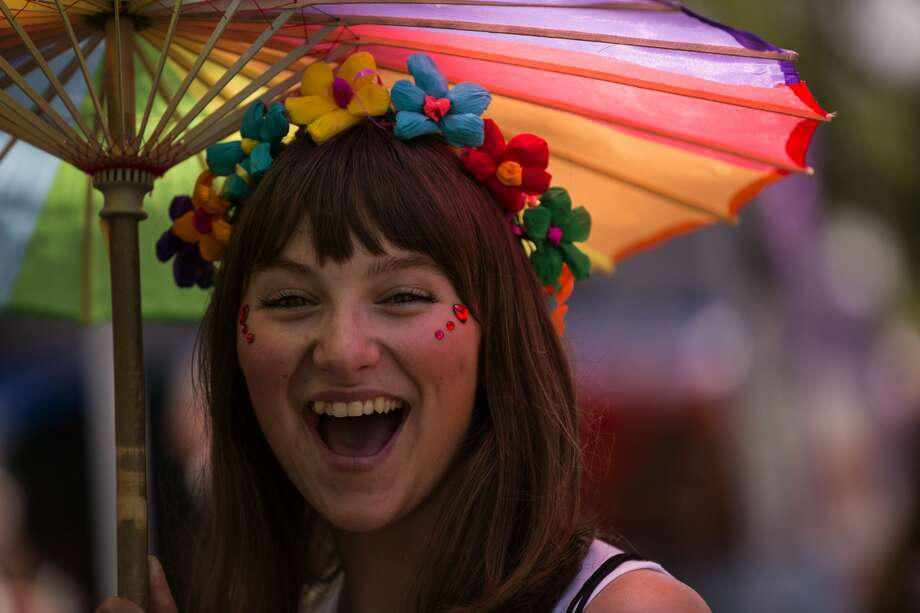 "Katelynn Bland, 18, smiles at 2019 Pride ""Bigger Than"" Texas Saturday, June 29, 2019 at Crockett Park in San Antonio. Photo: Rebecca Slezak/Staff Photographer"