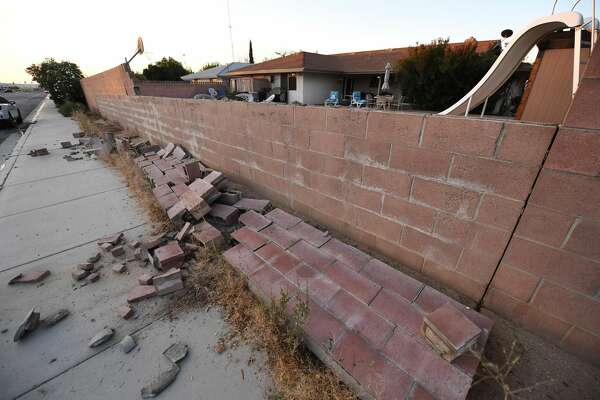 A cinderblock wall partially destroyed in Ridgecrest, California, on July 6, 2019, following a magnitude 7.1 earthquake on July 5. - Emergency rescue crews fanned out Saturday to assess damage from the second powerful earthquake to hit Southern California in as many days -- a 7.1 magnitude tremor that revived fears of the so-called Big One the region has feared for decades. No fatalities or serious injuries have been reported from this second quake, the largest in Southern California in more than two decades. (Photo by Robyn Beck / AFP) (Photo credit should read ROBYN BECK/AFP/Getty Images)