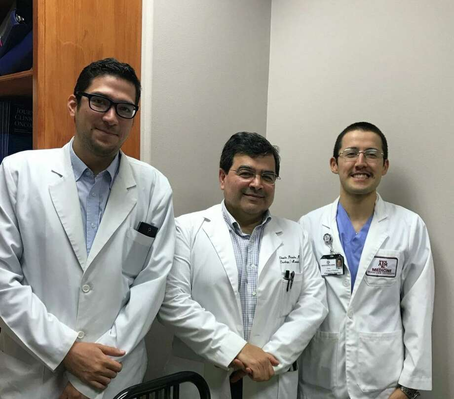 Dr. Eduardo Miranda, center, is pictured with medical students Rene Bulnes, left, and Alejandro Sanchez, right. Oncology and Hematology of South Texas, P.A. has been recognized by the QOPI Certification Program LLC, a wholly owned subsidiary of the American Society of Clinical Oncology, Inc. Photo: Courtesy