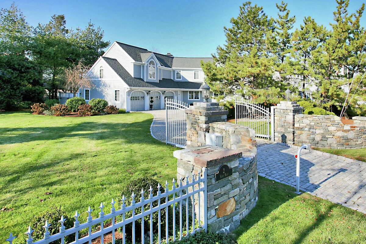 The house sits on a gated property of almost two-thirds of an acre in the Saugatuck Shores section of Westport.