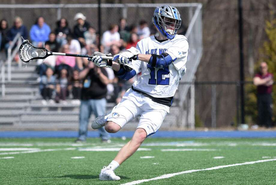Darien senior co-captain Tommy Hellman lines up a shot during the Blue Wave's boys lacrosse game against Yorktown (NY) at Darien High School on March 30, 2019. Photo: Dave Stewart / Hearst Connecticut Media / Hearst Connecticut Media
