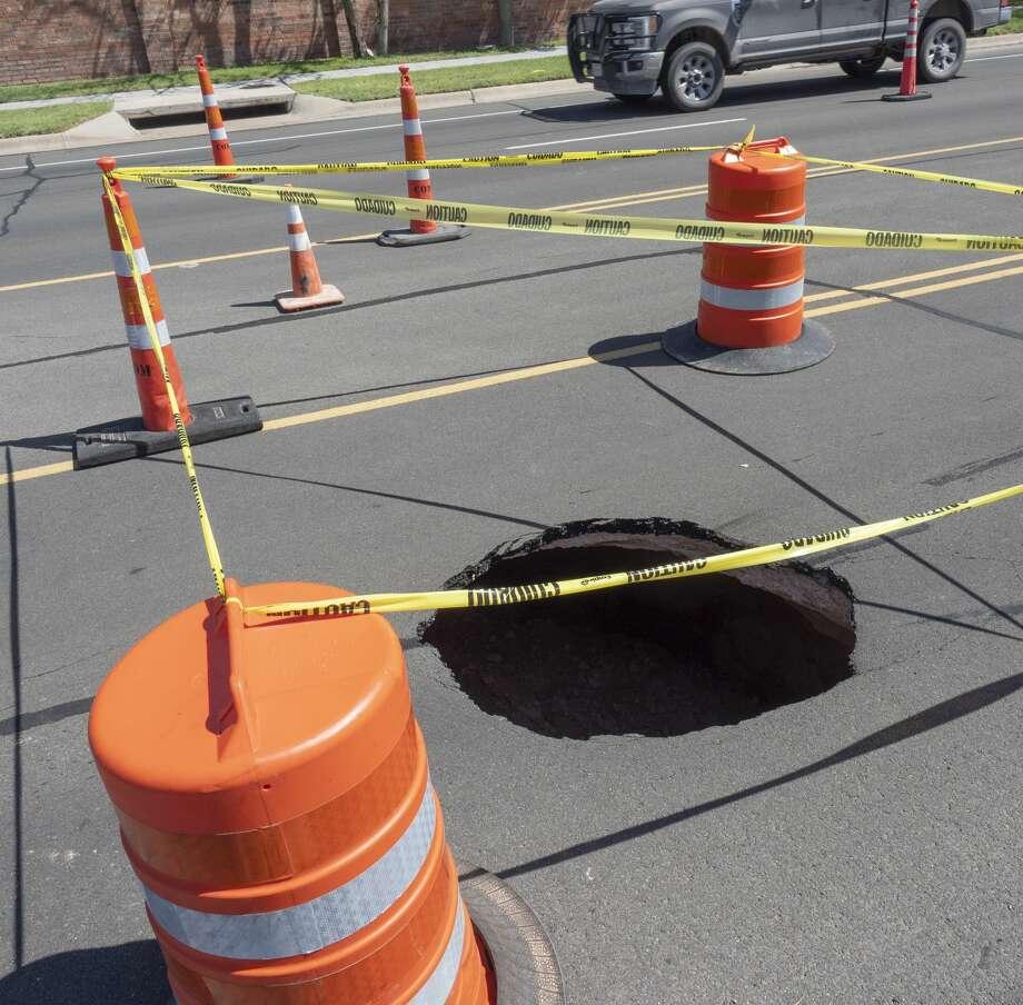 Sinkhole in the 4100 block of Mockingbird Lane. 07/08/19 Tim Fischer/Reporter-Telegram Photo: Tim Fischer/Midland Reporter-Telegram