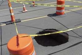 Sinkhole in the 4100 block of Mockingbird Lane. 07/08/19 Tim Fischer/Reporter-Telegram