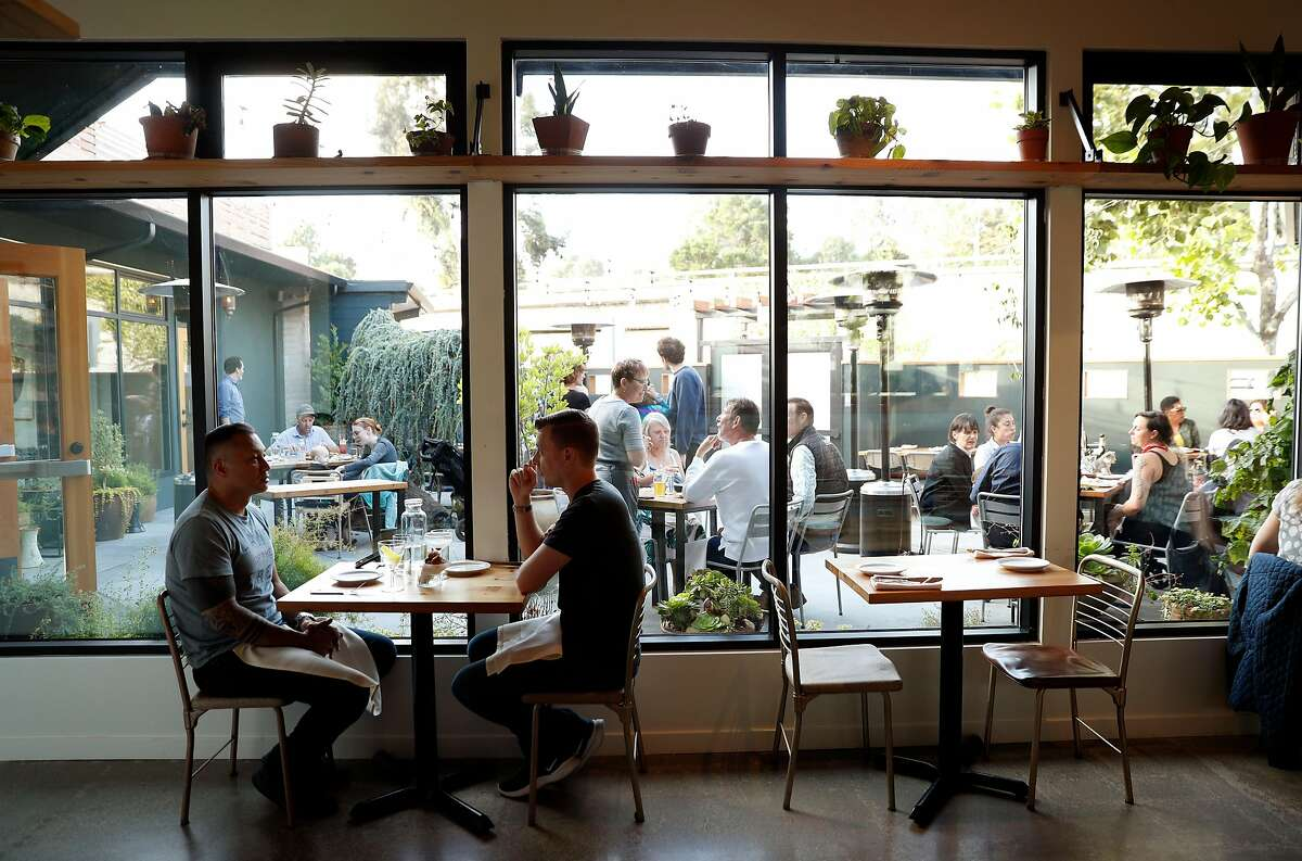 The view from the interior dining room to the courtyard dining area at Top Hat restaurant in San Leandro, Calif., on Wednesday, July 3, 2019.
