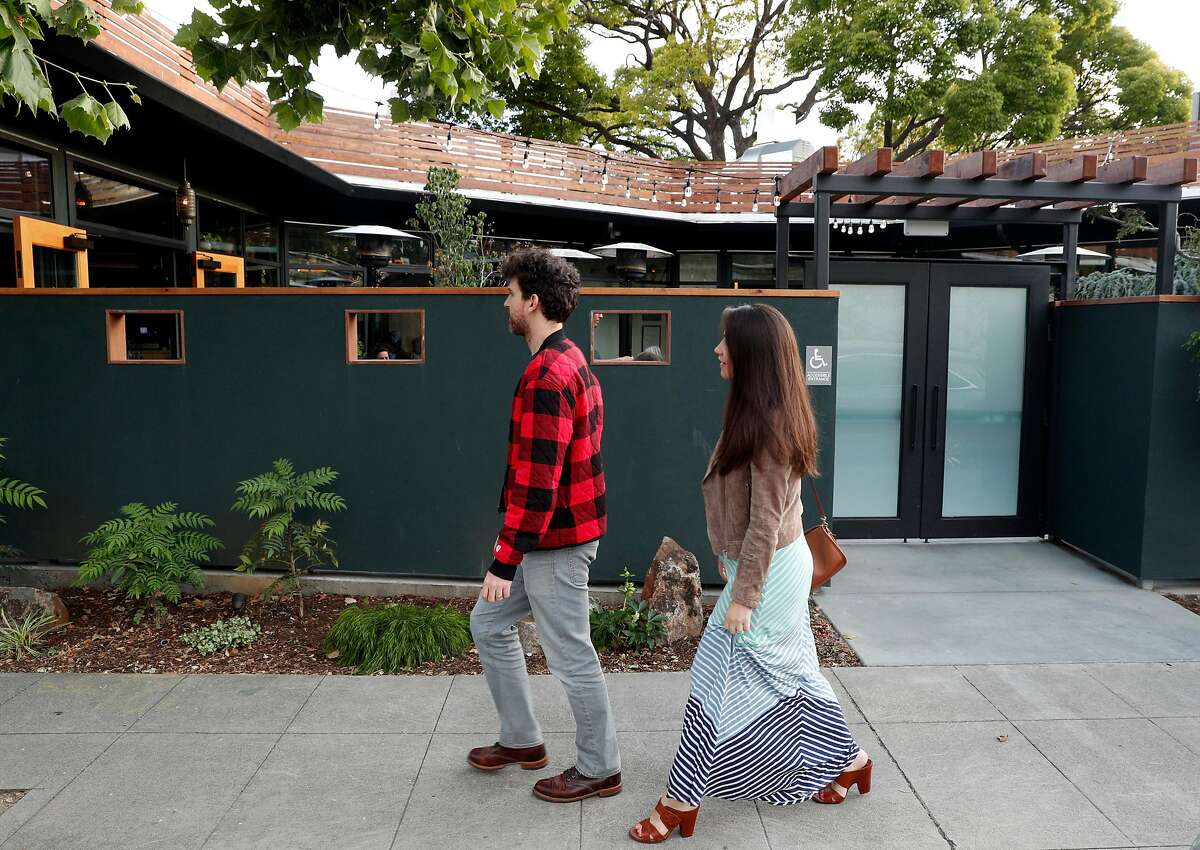 Guests arrive at Top Hat restaurant in San Leandro, Calif., on Wednesday, July 3, 2019.