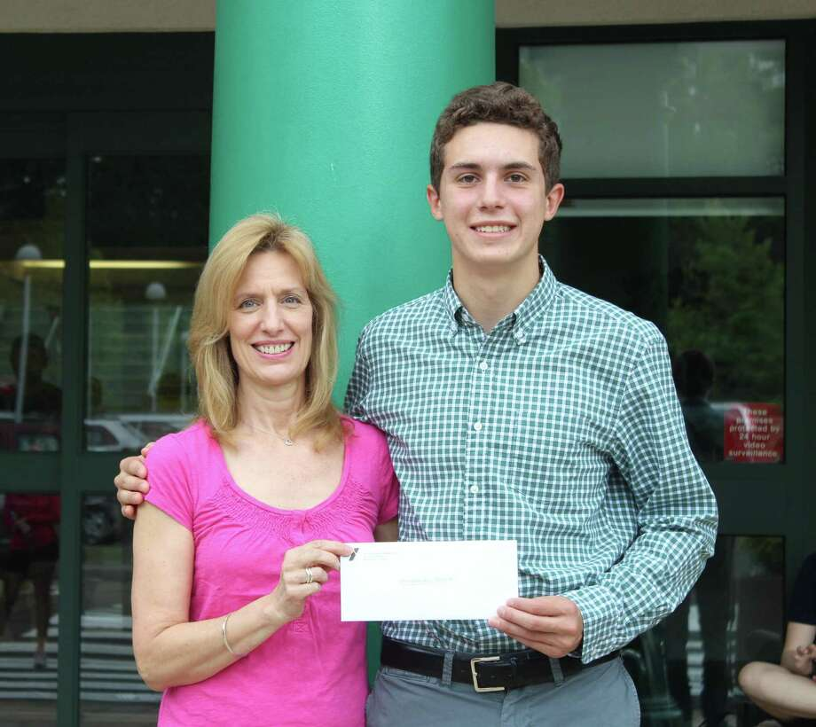 Mimi Conway, mother of Griffin Conway, presents the 2019 Griffin Conway Memorial Scholarship to Alessandro Sulpizi. Photo: Contributed Photo / New Canaan YMCA / New Canaan Advertiser Contributed