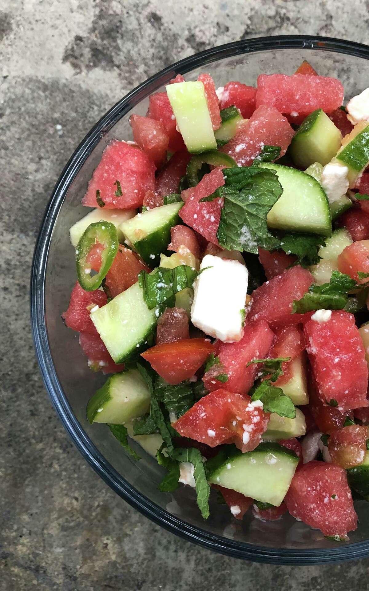 Watermelon, cucumber, tomato, feta, basil, mint, serrano and citrus make this summer salad sing.