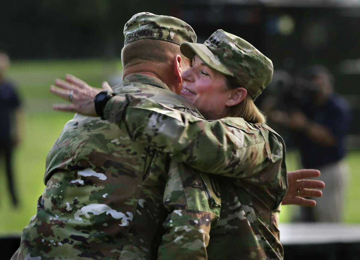 Lt. Gen. Jeffrey Buchanan, left, hugs Lt. Gen. Laura Richardson who took command of U.S. Army North during a ceremony at Fort Sam Houston on Monday.