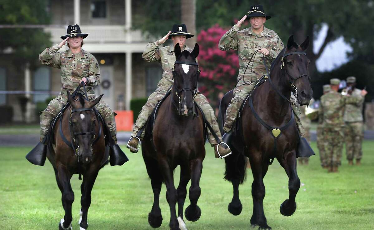 Lt. Gen. Jeffrey Buchanan, right, outgoing commander of U.S. Army North, and Lt. Gen Laura Richardson, left, the incoming commander, ride with Col. Niave Knell, U.S. Army North Chief of Staff, to review the troops during the change of command ceremony at Fort Sam Houston on Monday.